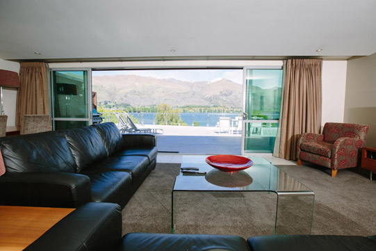 Penthouse Apartment Lounge balcony view of lake and mountains