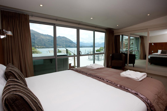 Penthouse Apartment Master Bedroom view of lake and mountains